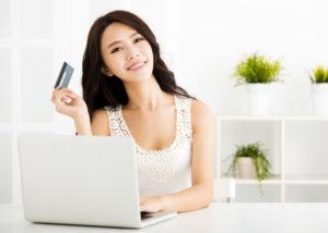 Berlibur pakai kartu kredit